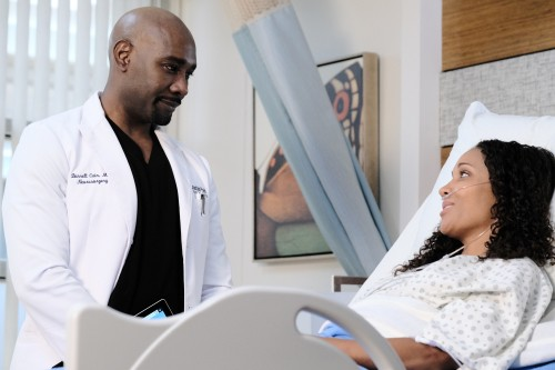 "THE RESIDENT:  L-R:  Morris Chestnut and guest star Aisha Kabia in the ""Burn it All Down"" season fin"