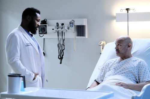 """THE RESIDENT:  L-R:  Malcolm-Jamal Warner and guest star Phillip Anthony-Rodriguez in the """"Burn it A"""